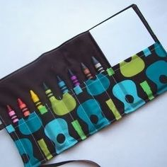 Crayon Roll with a little pad of paper. By New Beginnings