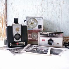 Collection of vintage Kodak cameras.