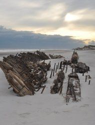 A wrecked schooner long buried on Fire Island — a barrier island off of Long Island, N.Y. — now lies fully exposed following Hurricane Sandy's attack on the beach.