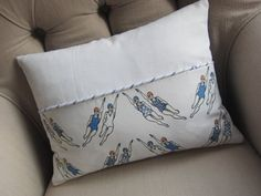 Retro swimmers cushion with denim blue back & appliqued swimmers on reverse.