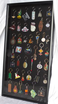 SOOO doing this with my keychains!! Finally, a way to display them!   Entirely Emily: Key chains, Key chains, and Key chains....oh my!