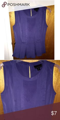 Attention peplum blue grey blouse. Once once! Lovely satin like sleeveless peplum blouse. It's. Grey-blue color. Once once. Great condition. 24 inches in length , about 14 inches from underarm. Tie/latch button in back. Accepts reasonable offers. trades or holds please. Attention Tops Blouses