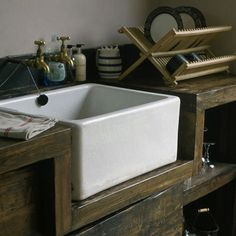 Rustic wood kitchen with farm house sink, I love this but I know the wood is not long lasting. It sure is pretty though.