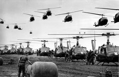 U.S. Army helicopters providing support for U.S. ground troops fly into a staging area fifty miles northeast of Saigon, Vietnam in January of 1966.