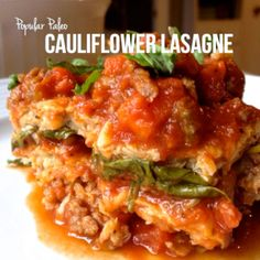 Cauliflower Lasagna- completely grain-free and dairy-free.Layered with spinach and a simple bolognese of mirepoix, tomatoes, chicken stock and Italian sausage.