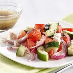 This Greek-inspired salad of cucumbers, tomatoes, red onion and feta cheese is dressed in a light and delicious Herb Vinaigrette.