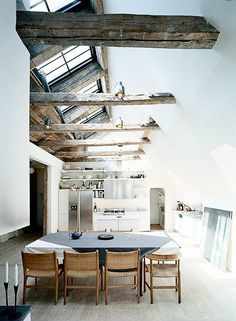 Exposed beams + white washed walls + skylights