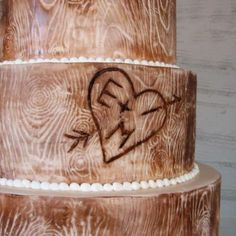 A wedding cake designed to look like a tree carving! Too cool!