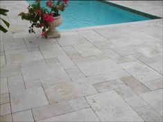 Are travertine tiles & pavers slippery when wet? Tumbled and unfilled travertine should be used externally around pool, pathways and pergolas (versus Chiseled or polished for only internal floor tile use). In regards to slipperiness tumbled and unfilled travertine has a coefficient of friction(.08) if I am not mistaken. That is very high and makes it NOT SLIPPERY. http://slatediscounts.com.au/travertine-pavers-tiles.php