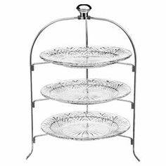 """Serve savory hors d'oeuvres and sweet treats in style with this 3-tier crystal serving rack, showcasing a classic etched motif.  Product: Serving rackConstruction Material: CrystalColor: Clear and silverFeatures: Three tiersDimensions: Overall: 20"""" H x 13.5"""" W x 12"""" DPlate: 12"""" Diameter each"""
