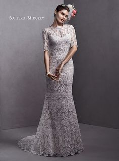 Gorgeous lace gown with detachable jacket.