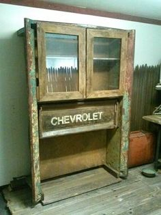 I do like industrial repurposing.  Vintage industrial repurposed Chevy truck bed medical cabinet desk.