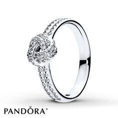 With its classic love knot design, this radiant ring from the PANDORA Mother's Day 2016 collection will add a timeless quality to your chosen look as well as subtle shimmer, created by rows of cubic zirconia stones set in sterling silver. Additional sizes may be available through special order at your nearest Jared location. Style # 190997CZ-54.