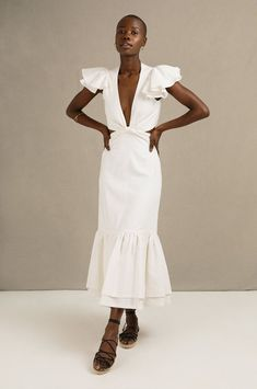Resort Wear designers aren't just for your honeymoon! Find our why we're recommending these lines for wedding dresses, too! Affordable, fashionable and often eco-friendly so many of our favorite designer fashion houses offer white gowns, jumpsuits, sets & suits worthy of your wedding day wardrobe under $1000. White Gowns, White Dress, Peacock Dress, High Waisted Pencil Skirt, Resort Wear, Designer Wedding Dresses, Designer Wear, Fitted Bodice, Wedding Accessories