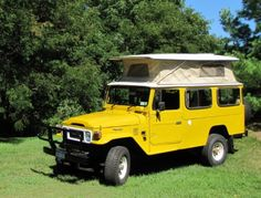 Great vintage Toyota Landcruiser with pop up camper