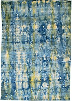 A Tibetan wool rug handwoven in China (certified child-labor-free) and tie-dyed with vegetable and chrome pigments