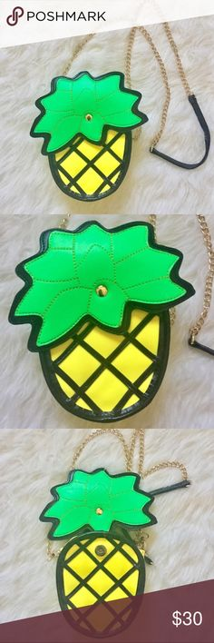 """Nasty Gal Pineapple Purse Like new, this sweet little crossbody has a magnetic fold over button flap, zippered closure and a detachable gold chain. Body is yellow and black with a green top. Measurements are approximate- 5.5""""/14cm width, 9""""/3cm height and 6.25""""/16cm depth. Snag this beauty up and sport the coolest trend this summer! Nasty Gal Bags Mini Bags"""