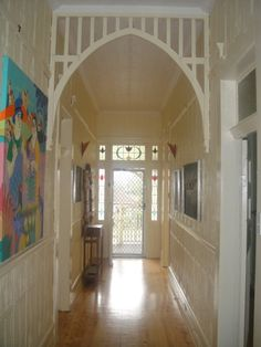 The hall as it is now. Pressed metal ceilings and walls, intricate fretwork, polished floors and lead light windows around the doors. A typical Federation-style Australian home. This house is heritage-listed