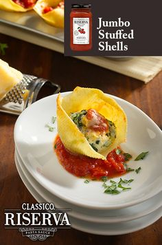 Fun appetizer for your next social gathering. Jumbo Stuffed Shells stuffed with spinach, Ricotta cheese, and Parmesan cheese topped with a dollop of Classico Riserva make for an hors d'oeuvere that will make the rounds!