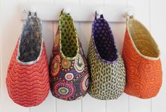 """Free-motionquilted hanging soft storage """"pods"""" designed by Love from Beth offer endless possibilities for organizing your home, car, cottage, or boat. These little pods can be stitche…"""
