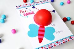 Bee Mine Valentine Eos Lip Balm Gift.  A cute little valentine bee flying by to say Bee Mine this Valentine's Day!  Makes a great teacher gift for Valentine's Day.  Simple and quick to put together, just print, cut and twist on a lip balm.