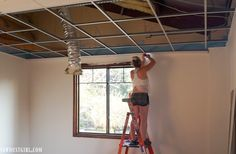 Install plank ceilings right onto a suspended ceiling grid! Change the appearance of suspended, acoustic tile ceilings -- with no demo! Drop Ceiling Basement, Drop Ceiling Grid, Wood Plank Ceiling, Drop Ceiling Tiles, Dropped Ceiling, Wood Ceilings, Drop Ceiling Lighting, Wood Planks, Basement Makeover