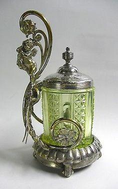 Reed-Barton-Victorian-1890s-Vaseline-Glass-Silver-Plate-Cherub-Pickle-Caster