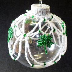 Irish Christmas - an ornament I beaded for my nephew and his new wife - Beaded shamrocks are surrounded by netting.