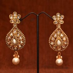 Anvi's uncut stones bridal earrings with pearls