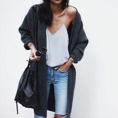 A cozy cashmere sweater + a silk slip tank with jeans and a Mansur Gavriel bucket bag.