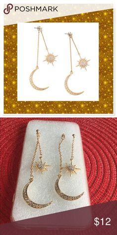 "Sun & Moon Rhinestone Earrings Fun and funky sun and moon dangle earrings. Goldtone alloy with rhinestones, 2 Pairs in one, wear sun alone or together with moon. Sun dangles are 2"" L, moon dangles are 4"" L. Jewelry Earrings"