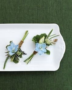 Light-blue delphinium, lisianthus buds, geranium foliage, veronica tips, and button ferns--> adapt for corsages!