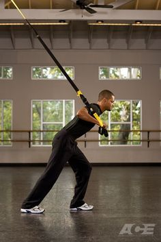 Step 1 Starting Position: Holding the TRX handles in each hand, turn to face away from the anchor point. Raise your elbows to chest height. Wrists should be in