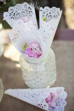 how we did rose petals to toss at our daughter's wedding - fastened with a monogram sticker <3