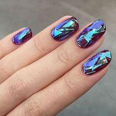 "Having ""Shattered Glass Nails"" is the latest trend in nail art. With their glossy textured look and feel, the light reflecting design looks just like glass. Move over, Bubble Nails, this new technique manages to be both innovative and eye-catching. For years, nail artist have been creating a similar look with holographic hoop tape, but recently, nail... View Article"