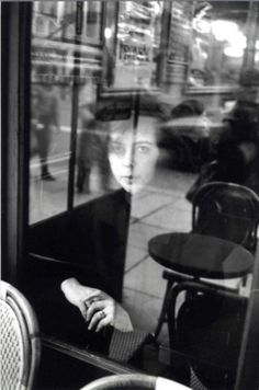 Edouard Boubat: 1923 – 1999 French art photographer.  Reflections that engage the psyche and the imagination of the viewer as well as the photographer are the most interesting images.  What is she thinking?  What are YOU thinking?  What is happening in the world around you?