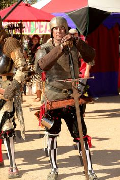 German landsknecht Chuck Hudson at the phoenix Arizona Renaissance Festival 2016 arms and armor, chainmail, two handed sword, German open face Sallet helmet