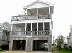Available July7, 14, and Aug 18 weeks.  This is a large 7-bedroom, 5-bath home with large decks and screened porch. View of ocean from decks. Less than 1/2 block to the beach. One block to the shops and restaurants in town. Central air conditioning and many other extras are built into this fine home.