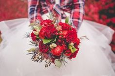 Barn inspired bridal bouquet. Bride in flannel. Red and navy bridal bouquet. Red and navy wedding flowers