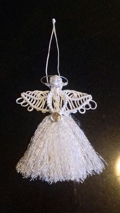 Small angel made from pattern on www.free-macrame-patterns.com