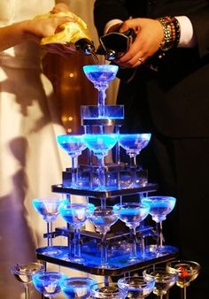 Do You Know The Secret Of Wedding Dinner Champagne Tower? The champagne tower symbolizes sweet love, an eternal memory of marriage. When the couple opens the champagne, & slowly pour it over the multi-layer cup tower, it means that the bride & groom respect each other, their love will be eternal, a symbol of happiness on lifes' road. The Champagne tower should conform to the couples height, 4 – 5 layers are the best. The glasses should be unified standards. Red wine glasses are not suitable.