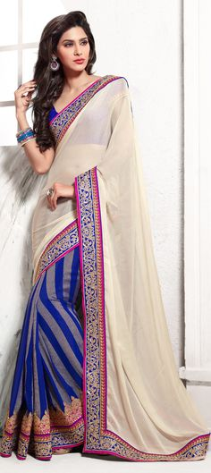 149816: #STRIPES do one of the best print blocking. Check out this #saree for parties.  #Partywear #embroidery #sale #newyear #designerwear #wedding #pastel #onlineshopping