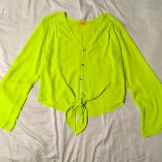 Neon tie top with wide sleeves Make a statement in this neon flowy sheer top! Very flattering on! Loose fitting and breathable 100% polyester. Tops Blouses
