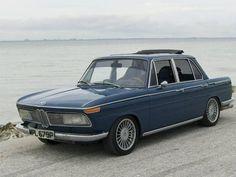 Google Image Result for http://bringatrailer.com/wp-content/uploads/2009/04/1970_BMW_2000_Neue_Klasse_Sedan_For_Sale_Front_1.jpg