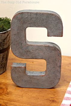 """The Cozy Old """"Farmhouse"""": DIY Faux Metal Industrial Letters. love her diy- but I would mod podge over the silver paint, then add a stain over and rub it off ;) mod podge one more coat to seal"""