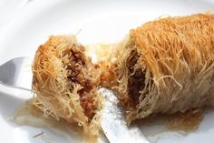 Bosnian Kadaif - The threads are used to make pastries of various forms (tubes or nests), often with a filling of chopped nuts, like that used for baklava. A kadaif pastry is made by putting down a layer of wire kadaif, then a layer of a filling of chopped nuts, then another layer of wire kadaif. The pastries are painted with melted butter, baked until golden brown, then drenched in sugar or honey syrup.