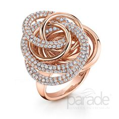 Parade Design BD3246A. Swirls of pink gold and diamonds evoke the beauty of a rose.