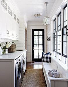 Black and White Mud/Laundry Room | Content in a Cottage | breezeway mudroom, built in cabinets, laundry, black windows and door