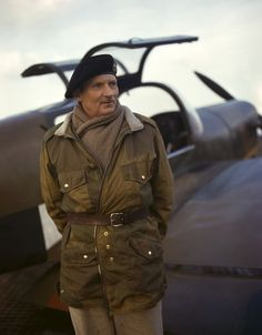 A rare wartime portrait of Montgomery of Alamein sporting paratrooper's camouflage tunic and substantial scarf; posing next to a M-38 Messenger, 1943.