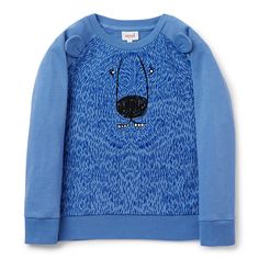 100% Cotton French Terry Sweater. 2x2 rib cuffs, neckband and hem. Features raglan sleeve, novelty bear face and fur placement print and applique ears in sleeve seam. Regular fitting silhouette. Available in Puddle Blue.